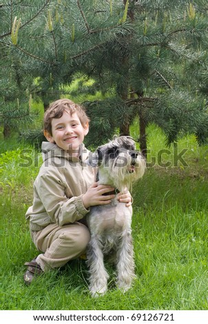 Boy with his dog at the park - stock photo
