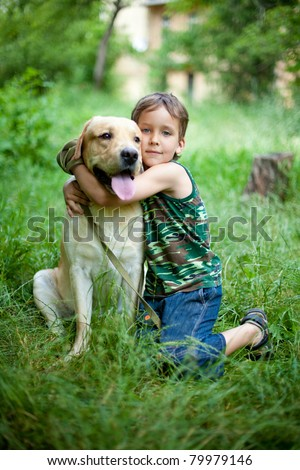 Boy with his dog in the park - stock photo