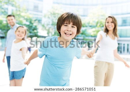 Boy with his family in the background  - stock photo