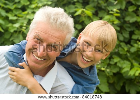 boy with his   grandparent play at nature