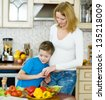 Boy with his pregnant mother - stock photo