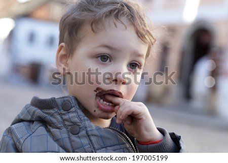 Boy with ice cream on his lips
