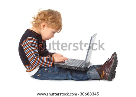 Boy with laptop at profile - stock photo