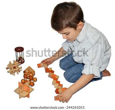 Boy with many wooden logic toys - stock photo