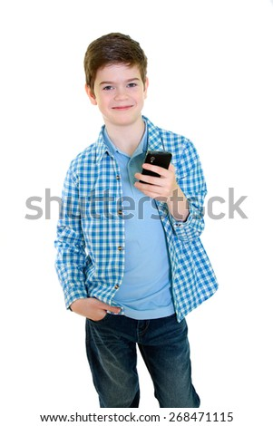 Boy with mobile phone over white background - stock photo
