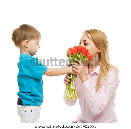 Boy with mother on white background (child, kid  with bouquet of flowers ), pretty woman and cute cheerful child play game; happy smiling young lady hugging son -  family and mother`s  day concept - stock photo