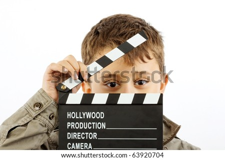 Boy with movie clapper board over white - stock photo