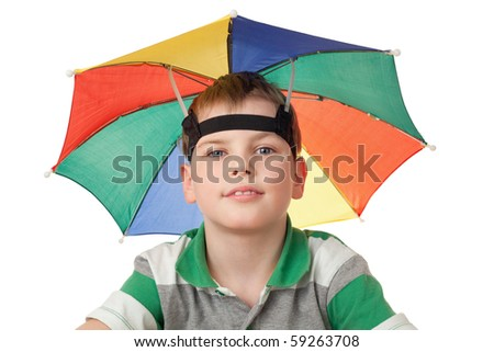 boy with multi-coloured umbrella on head isolated on white background