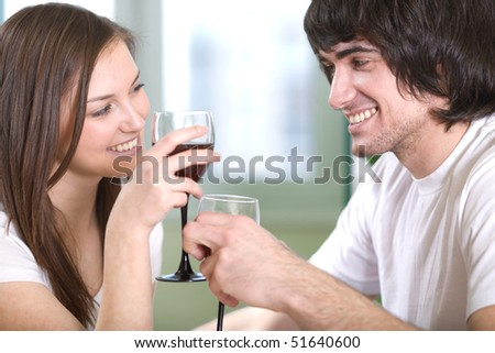 Boy with nice girl with wineglasses - stock photo