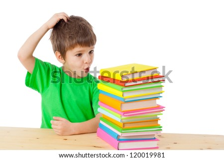 Boy with pile of books scratching his head, isolated on white - stock photo