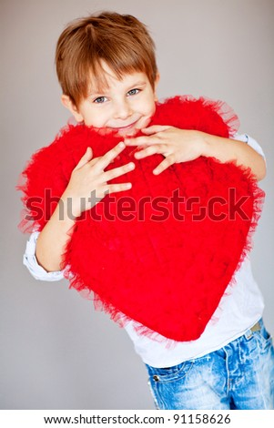 Boy with red heart - stock photo