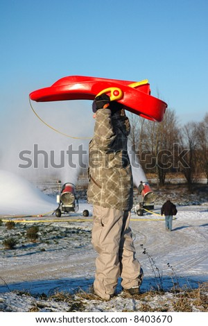 boy with red sledge