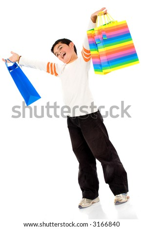 boy with shopping bags over a white background - stock photo