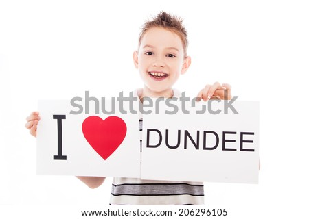 Boy with  sign I love Dundee. Series of boy with English city signs - stock photo