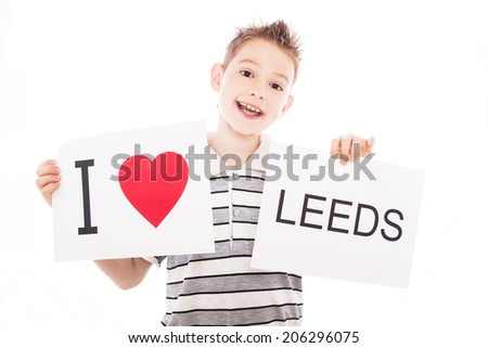 Boy with  sign I love Leeds  . Series of boy with English city signs - stock photo