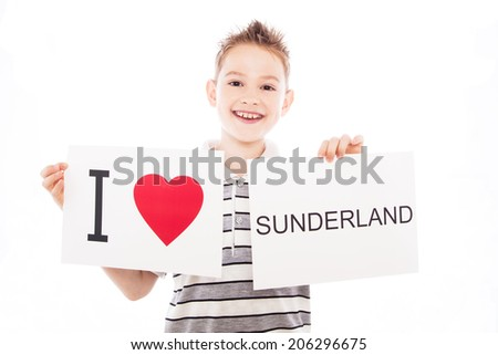 Boy with  sign I love Sunderland. Series of boy with English city signs - stock photo