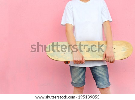 boy with Skateboard wearing - stock photo
