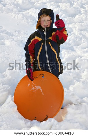 Boy with Sled Giving the Thumbs Up - stock photo