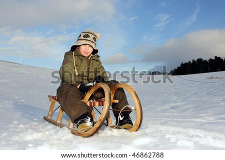 boy with sledge - stock photo