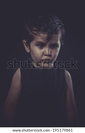 boy with slicked-back hair, funny and expressive - stock photo