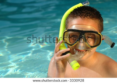 Boy with snorkeling equipment on a hot summer day - stock photo