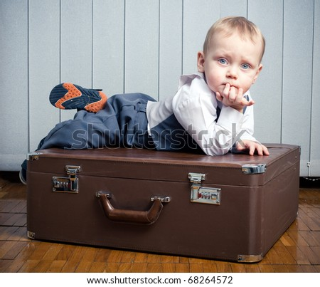 boy with suitcase - stock photo