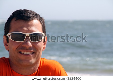boy with sunglasses in the beach