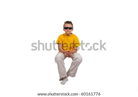 boy with sunglasses sit in air, isolated on white background - stock photo