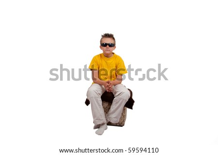 boy with sunglasses sit on cube, isolated on white background - stock photo
