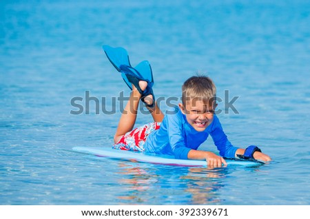 Boy with surf - stock photo