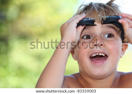 Boy with swimming goggles - stock photo
