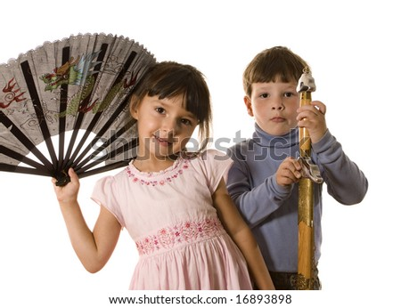 Boy with sword and girl with fan on white - stock photo