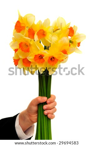 Boy with the bunch of daffodils isolated on the white background.