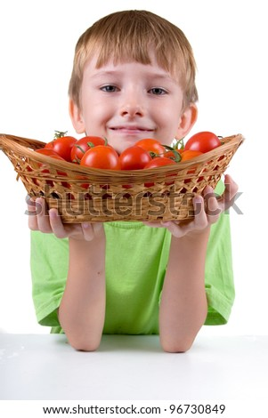 Boy with tomatoes isolated on a white background - stock photo