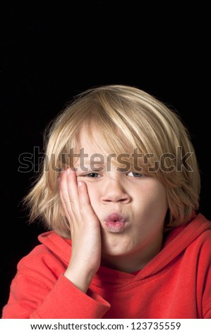 Boy with toothache - stock photo