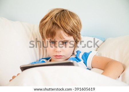 Boy with touchpad tablet Learing playing