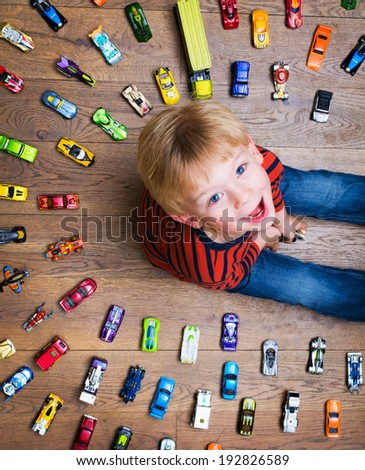 Boy with toy cars - stock photo