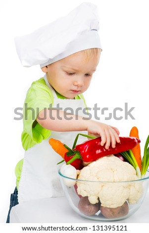 boy with vegetables isolated on a white background - stock photo