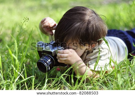Boy with vintage film camera - stock photo