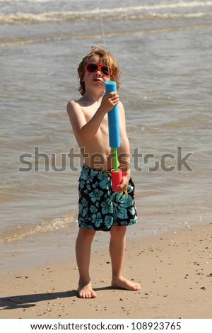 boy with water gun - stock photo