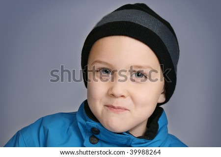 boy with winter clothes - stock photo