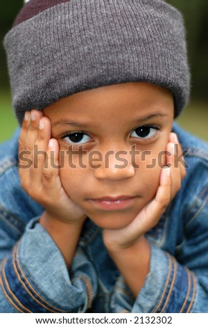 Boy wondering - stock photo