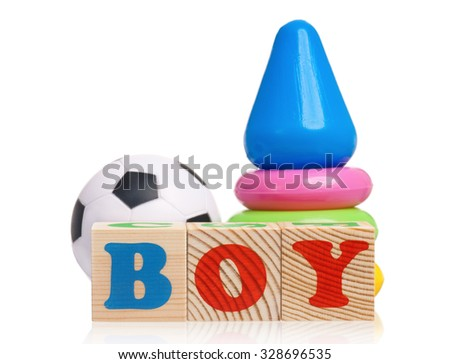 Boy word formed by wood alphabet blocks with pyramid on white background  - stock photo