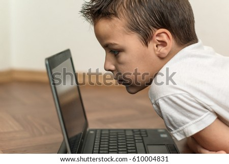 boy working on a laptop, computer generation