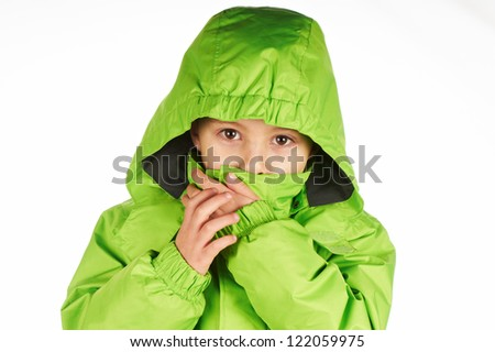 Boy wrap themselves in a warm winter jacket green color