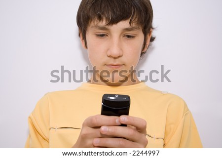 boy writes the message on the  cell telephone