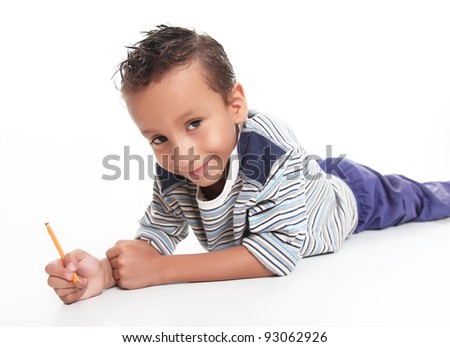 Boy writing and looking at the camera smiling