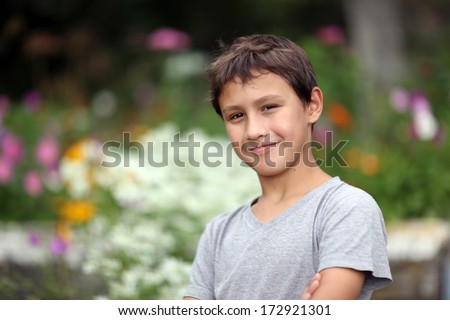 boy 10 years old against summer flower