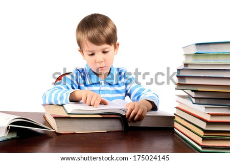 boy 5 years reading a big book. isolated on white background. horizontal