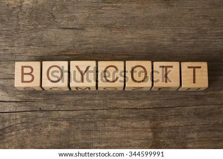 BOYCOTT text on a wooden background - stock photo